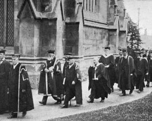 Academic staff in procession for the University of Otago's jubilee function. At the head is the...