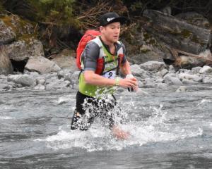 Dougal Allan works his way through a stream at last year's Coast to Coast event. PHOTOS: WAYNE...