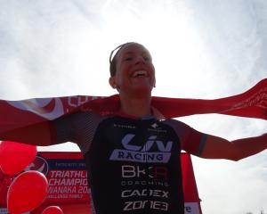 Radka Kahlefeldt, of the Czech Republic, is all smiles after winning the Challenge Wanaka women's...