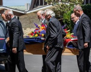 Mike Moore's casket is carried into his funeral service in Auckland. Photo: RNZ / Dan Cook