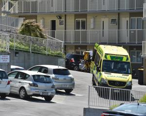 An ambulance attend to a patient injured in a small fire in an apartment complex on Park St....
