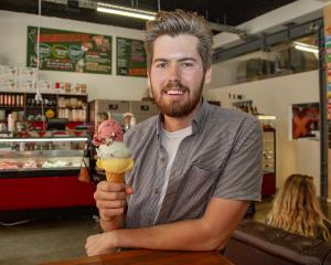 Rollickin' Gelato owner Jed Joyce with an impressive stack of gelato from his new Cashel St store...
