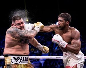 Anthony Joshua gets a right hand past the defences of Andy Ruiz jun during their heavyweight...