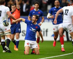 France's Vincent Rattez celebrates after scoring their first try against England. Photo: Getty