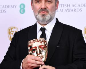 Sam Mendes with the Best Director award for 1917. Photo: Getty