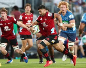 Richie Mo'unga of the Crusaders makes a break against the Blues. Photo: Getty