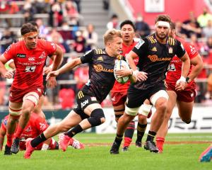 Damian Mckenzie goes on a run for the Chiefs against the Sunwolves. Photo: Getty Images