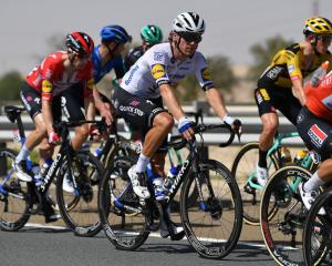 New Zealand's Shane Archbold (white shirt) competing in Jebel Hafeet this week. Photo: Getty Images