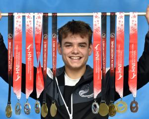 Alex Livingstone (16) celebrates with his 11 medals at the Dunedin Gymnastics Academy earlier...