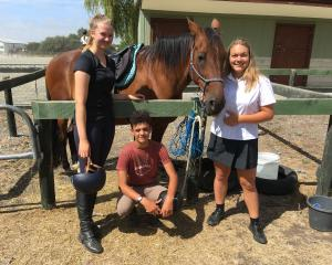International students Hanna Vowmers, left, aged 17, Ismael Markria, 15, and Alina Prein, 16, are...