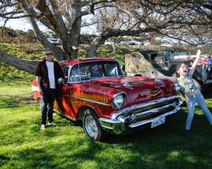 Jamie Philpott, of Waikuku Beach, with his gleaming 1957 Chevrolet Bel Air, Ruby, and his niece...