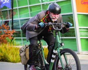 Arana College warden and Otago Residential Colleges senior warden Jamie Gilbertson rides his bike...