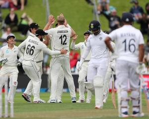 New Zealand's Kyle Jamieson celebrates the wicket of India's Cheteshwar Pujura with teammates....
