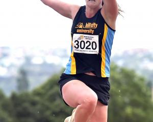 Madeleine Lindemann jumps on her way to a win in the women's triple jump at the Caledonian Ground...
