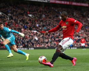 Manchester United's Odion Ighalo takes a shot at goal against Watford this morning. Photo: Getty...