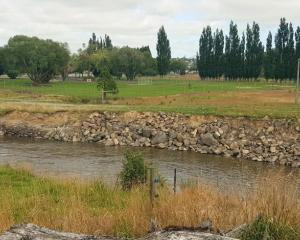 The recent flooding exposed an old landfill in Gore. Photo: Gore District Council