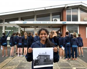 St Hilda's Collegiate School year 9 pupil Thareni Luxmanan (13) holds a photo of how the school...