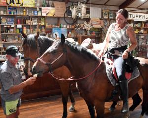 Kieran O'Neill (Ranfurly), holding his horse Harry, cools Charlie off with an ice-cream at...
