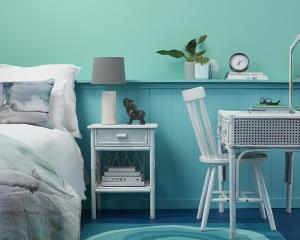 With walls in Resene Freelance and paneling in Resene Yes Please, this bedroom is about as aqua...