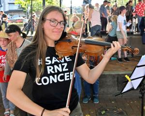 Dunedin Symphony Orchestra violinist Frances Christian-Farrow (20) takes part in the Save RNZ...