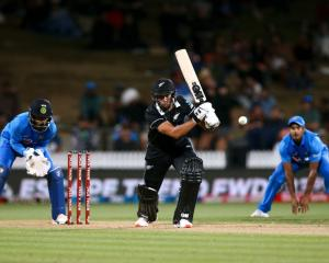 Ross Taylor plays the ball through the offside on his way to a century against India at Seddon...