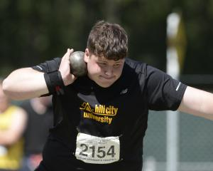 Joel Bolton (18) from Hill City United winds up in a shot put attempt at the Caledonian Ground on...