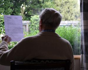 A Mosgiel pensioner reads a letter from the Southern District Health Board telling him the...