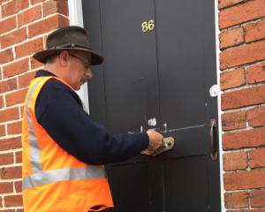 City custodian Peter Moroney delivers a Dunedin City Council Welcome To Your Flat pack, which...