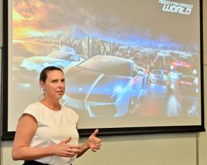 International game developer Tabitha Hayes speaks to about 30 summer school students at the...