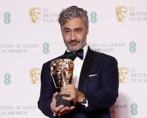 Taika Waititi with his award for Adapted Screenplay for 'Jojo Rabbit' at this year's Baftas....