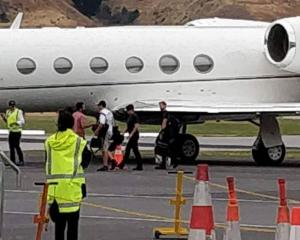 Tom Cruise wearing black, second from right about to depart from Queenstown. Photo: Supplied