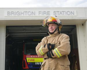 "Volunteer firefighter Colin Astle: ""'You look after your buddy and he looks after you.'' PHOTO:..."