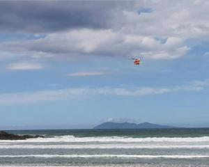 Auckland Westpac Rescue Helicopter helps with the search at Waihi Beach. Photo: Supplied via NZ...