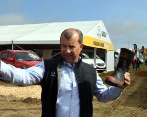 Gore motor vehicle dealer Leslie Baxter is enjoying a break away from his flood-affected...