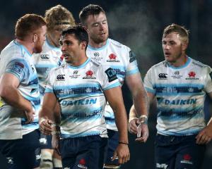 Nick Phipps and his Waratahs team mates look on during their loss to the Highlanders in...
