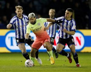 Manchester City's Sergio Aguero in action with Sheffield Wednesday's Tom Lees and Joey Pelupessy....