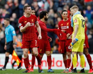 Liverpool's James Milner celebrates after the match. Photo: Reuters