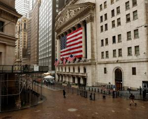 US flags fly outside the New York Stock Exchange. Photo: Reuters