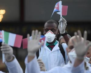 An emergency contingent of doctors and nurses arrives at Malpensa airport near Milan after...