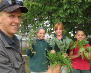Hinds School pupils Kezia Fox (holding Scottish Thistle), Matisse Eccelstone (kale) and Fabian...