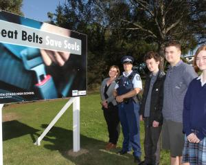 Presenting one of six new road safety billboards designed by South Otago pupils are (from left)...