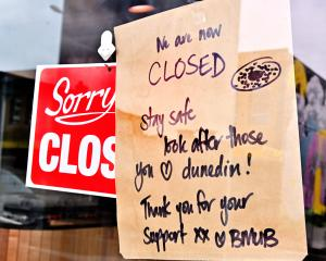 One of the many signs on businesses around Dunedin advising of closure. PHOTO: ODT FILES