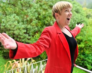 Lois Johnston, of Careys Bay, sang an aria for her neighbours from her balcony on Sunday. PHOTO:...