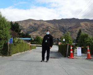 Security guard Tilaram Acharya restricting entry to the Wanaka's Lake View Holiday Park. PHOTO:...