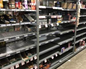 Empty shelves on the day before lockdown Photo: Photo: RNZ