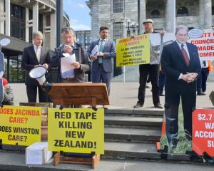Colin Wightman speaking at the grounds of Parliament at a protest for legislation to protect tiny...