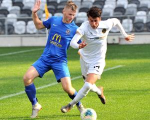 Southern United's Andrew Cromb (left) looks to close down Team Wellington's Jack-Henry Sinclair...