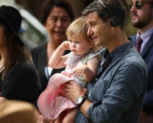 Neve Te Aroha Arden Gayford, with her dad, Clarke Gayford, listens to her mother Jacinda Ardern...