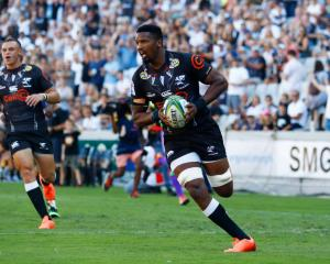 Sharks player Sikhumbuzo Notshe runs in to score against the Jaguares. Photo: Getty