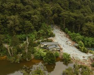 About 30 people were inside Howden Hut on the Routeburn Track when a landslip crashed into it...